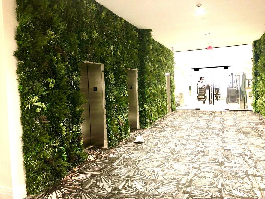 VistaGreen artificial green wall paneling can be mounted to any surface, wood framing was used to fill in depressions in the wall to create a seamless vertical garden look. - Philadelphia PA